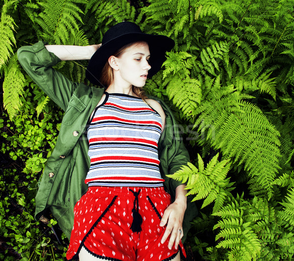 Pretty young blond girl hipster in hat among fern, vacation in g Stock photo © iordani