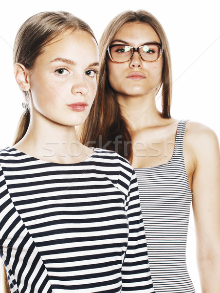 two young workers isolated on white, same dresses in strip Stock photo © iordani