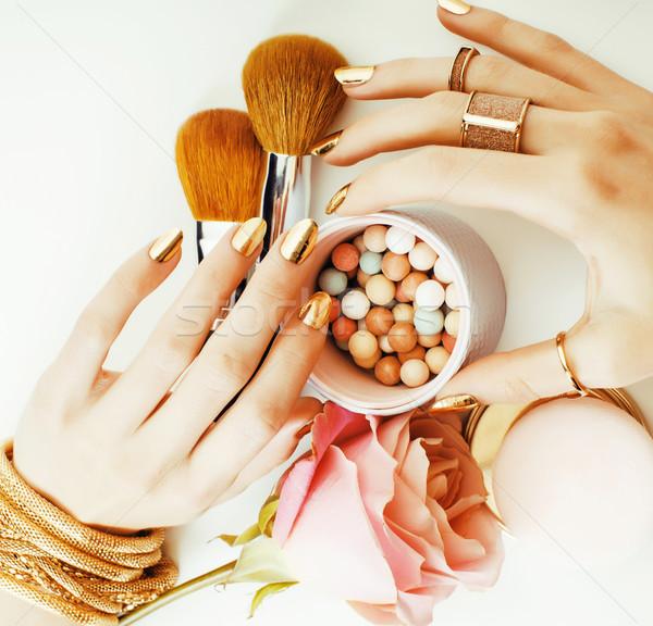 Mulher mãos dourado manicure muitos anéis Foto stock © iordani