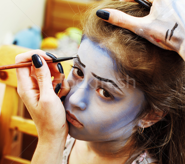 Stock photo: little cute child making facepaint on birthday party, zombie Apo