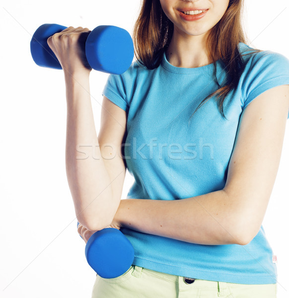 young pretty brunette woman with blue dumbbell isolated cheerful smiling, part of body, diet people  Stock photo © iordani