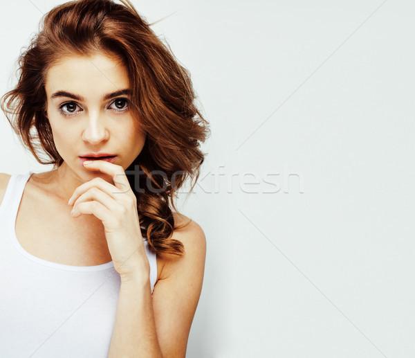 young pretty teenage girl emotional posing, happy smiling isolated on white background, lifestyle pe Stock photo © iordani