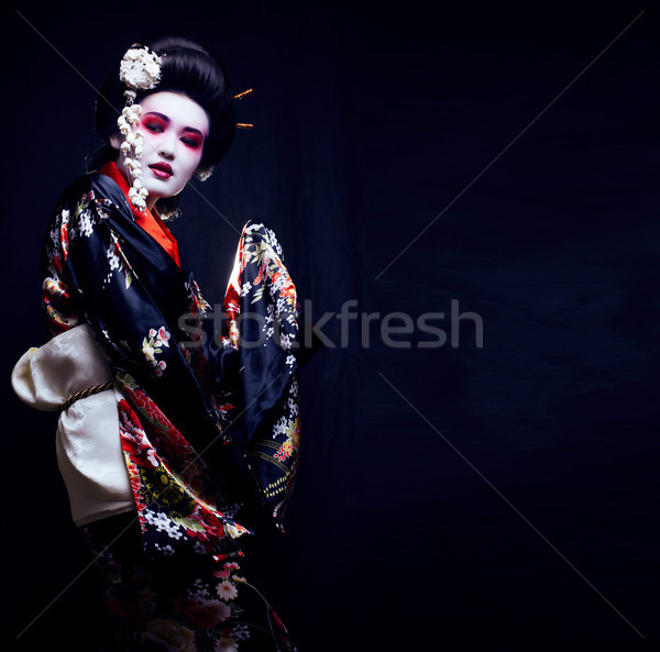 young pretty geisha in kimono with sakura and decoration Stock photo © iordani