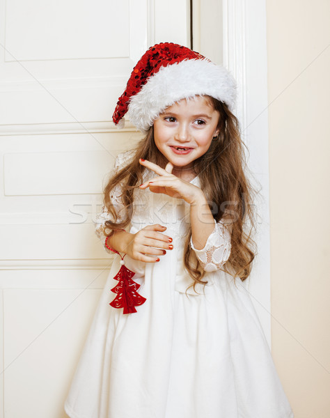 little cute girl in santas red hat waiting for Christmas gifts. holiday lifestyle people concept Stock photo © iordani