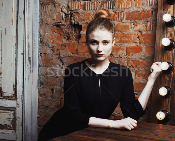 young stylish woman in make up room with mirror, diva actress before perfomance thinking art. loft i Stock photo © iordani