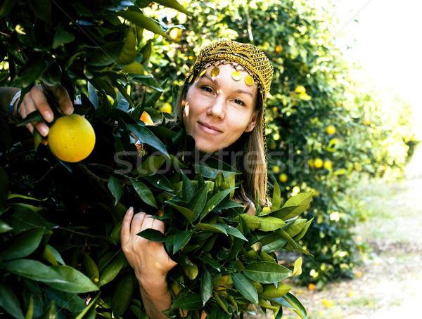 pretty islam woman in orange grove smiling Stock photo © iordani