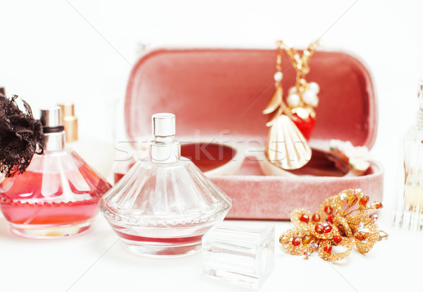 Jewelry table with lot of girl stuff on it, little mess in cosmetic brushes, interior concept Stock photo © iordani