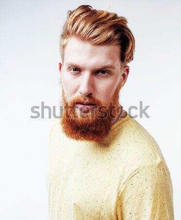 young handsome hipster bearded guy looking brutal isolated on white background, lifestyle people con Stock photo © iordani