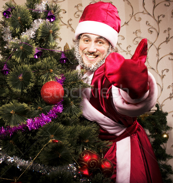 portrait of funny Santa Claus at home with christmass tree Stock photo © iordani