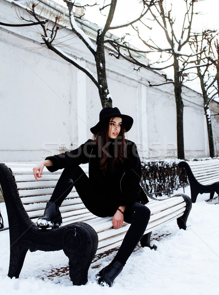young pretty modern hipster girl waiting on bench at winter snow park alone, lifestyle people concep Stock photo © iordani