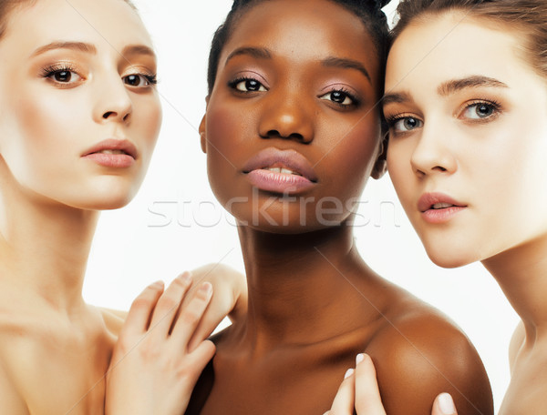 different nation woman: african-american, caucasian together isolated on white background happy smil Stock photo © iordani