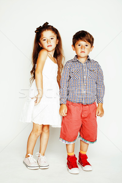 little cute boy and girl hugging playing on white background, ha Stock photo © iordani