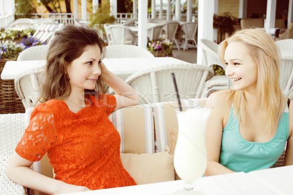 portrait of two pretty modern girl friends in cafe open air inte Stock photo © iordani