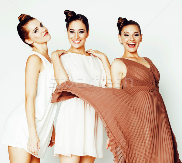 three pretty stylish young woman with same hairstyle and makeup, Stock photo © iordani