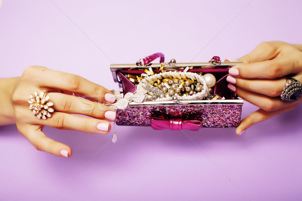 little girl stuff for princess, woman hands holding small cute handbag with jewelry and manicure, lu Stock photo © iordani