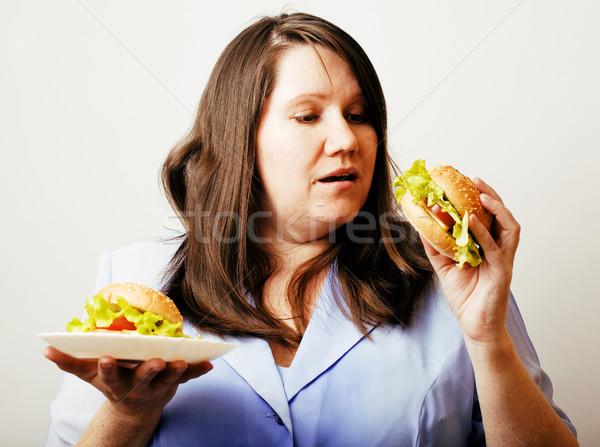 fat white woman having choice between hamburger and salad close  Stock photo © iordani