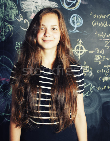 back to school after summer vacations, cute teen real girl in classroom Stock photo © iordani