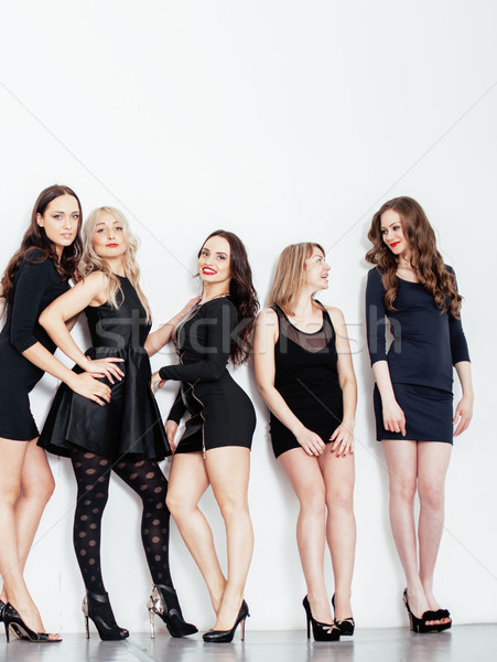 Many diverse women in line, wearing fancy little black dresses, party makeup, vice squad concept lif Stock photo © iordani