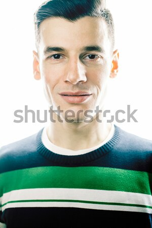 Portrait of a smart serious young man standing against white bac Stock photo © iordani