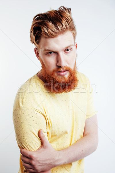 Fiatal jóképű hipszter gyömbér szakállas fickó Stock fotó © iordani