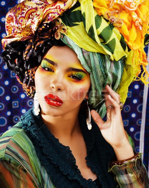beauty bright woman with creative make up, many shawls on head like cubian woman Stock photo © iordani