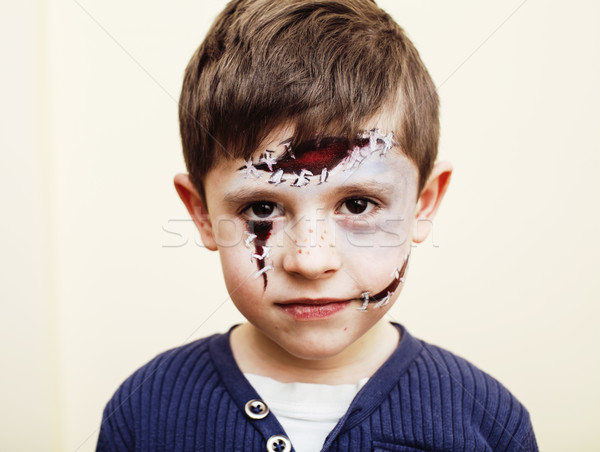 little cute boy with facepaint like zombie apocalypse at hallowe Stock photo © iordani