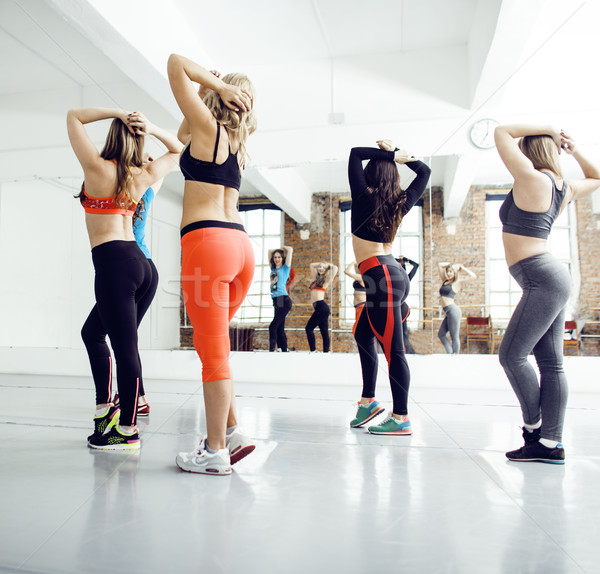 Women doing sport in gym, healthcare lifestyle happy people concept, modern loft studio, flying in j Stock photo © iordani