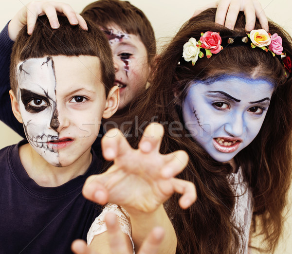 Stock photo: zombie apocalypse kids concept. Birthday party celebration facep