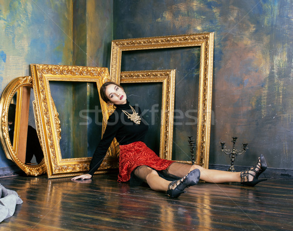 beauty rich brunette woman in luxury interior near empty frames, vintage elegance close up Stock photo © iordani