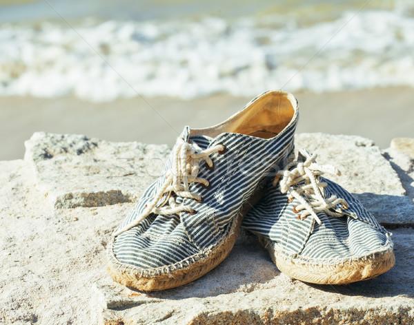 Kép klasszikus öreg rongyos sportcipők igazi Stock fotó © iordani