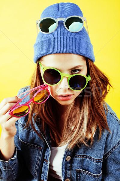 young pretty teenage woman emotional posing on yellow background, fashion lifestyle people concept  Stock photo © iordani