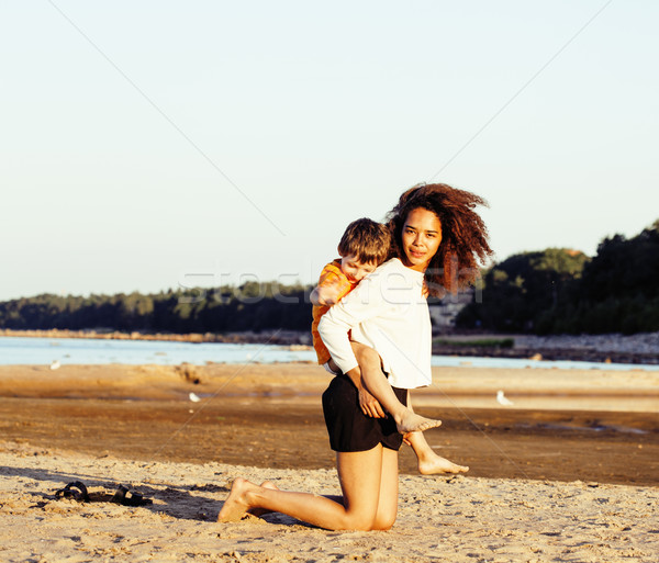 pretty diverse nation and age friends on sea coast having fun, lifestyle people concept on beach vac Stock photo © iordani