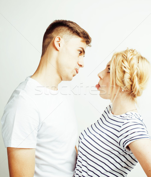 young pretty teenage couple, hipster guy with his girlfriend happy smiling and hugging isolated on w Stock photo © iordani