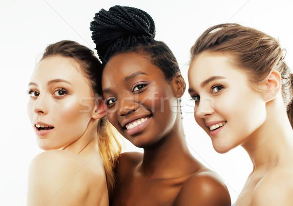 Tres diferente nación mujer caucásico junto Foto stock © iordani