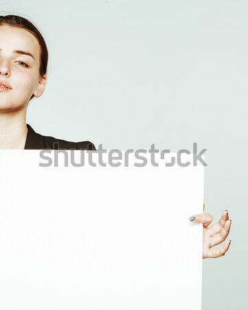 young pretty brunette girl with placard on white background Stock photo © iordani