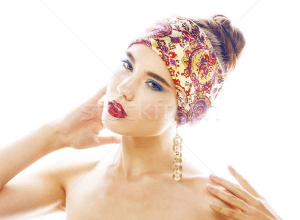 young pretty modern girl with bright shawl on head emotional posing isolated on white background, as Stock photo © iordani