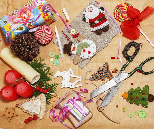 handmade christmas gifts in mess with toys, candles, fir, ribbon, tree cone wooden vintage, post car Stock photo © iordani
