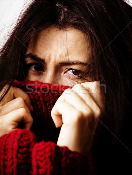 young brunette gloomy woman in sweater all over her face, messed hair Stock photo © iordani
