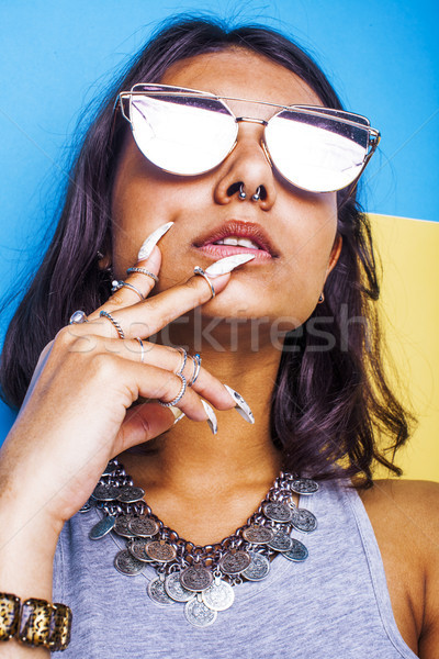 lifestyle people concept. young pretty smiling indian girl with long nails wearing lot of jewelry ri Stock photo © iordani
