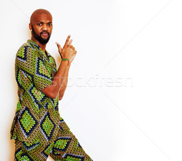 portrait of young handsome african man wearing bright green national costume smiling gesturing, ente Stock photo © iordani