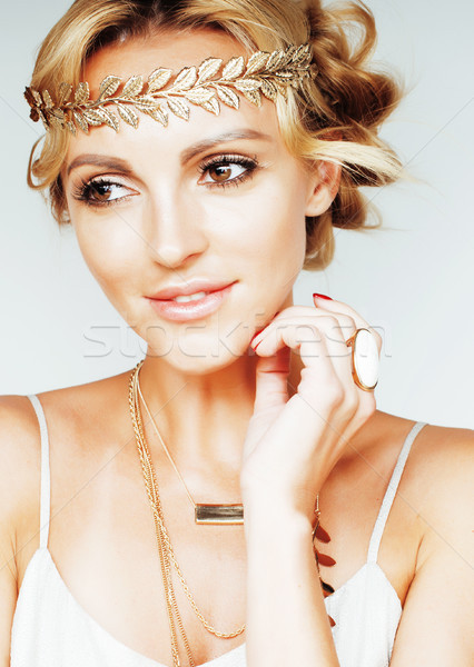 young blond woman dressed like ancient greek godess, gold jewelr Stock photo © iordani