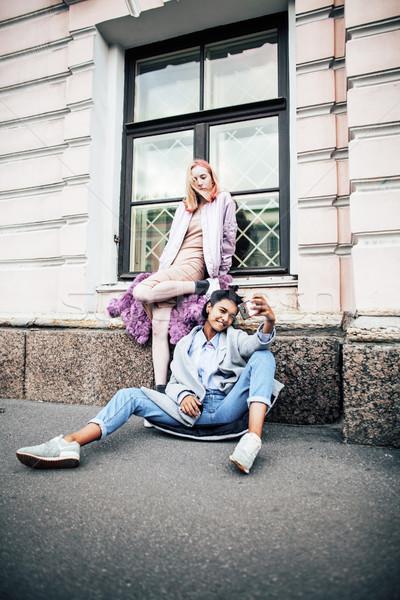 cute young couple of teenagers girlfriends having fun, traveling Stock photo © iordani