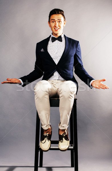 young handsoman businessman fooling aroung with chair, wounderin Stock photo © iordani
