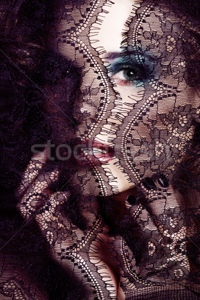 portrait of beauty young woman through lace close up mistery mak Stock photo © iordani