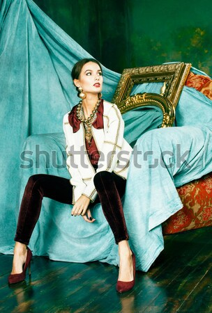 beauty rich brunette woman in luxury interior near empty frames, vintage elegance Stock photo © iordani