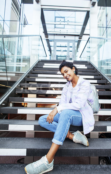 young cute indian girl at university building sitting on stairs  Stock photo © iordani