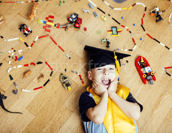 little cute preschooler boy among toys at home in graduate Stock photo © iordani