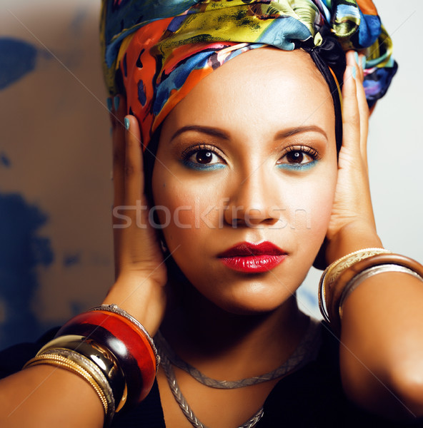 beauty bright african woman with creative make up, shawl on head like cubian woman Stock photo © iordani