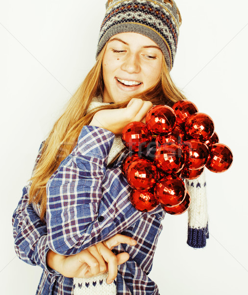 Stock photo: young pretty blond teenage girl in winter hat and scarf on white