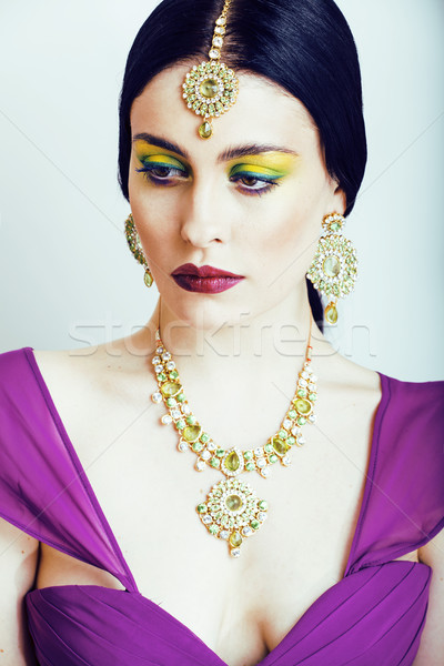 young pretty caucasian woman like indian in ethnic jewelry close up on white, bridal makeup Stock photo © iordani